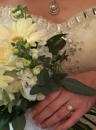 Close up of bridal bouquet, bride's hand with ring, and a necklace Olde Square Inn Mount Joy PA