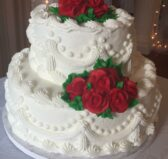 White two-tiered wedding cake with red roses Olde Square Inn Mount Joy PA