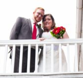 Newly weds looking down from a balcony at OldeSquare Inn Mount Joy PA
